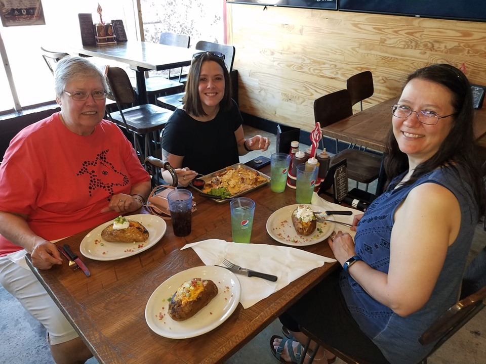 Here we are enjoying loaded baked potatoes and nachos at Smoky Oak Taproom. My husband and I rave about these potatoes!